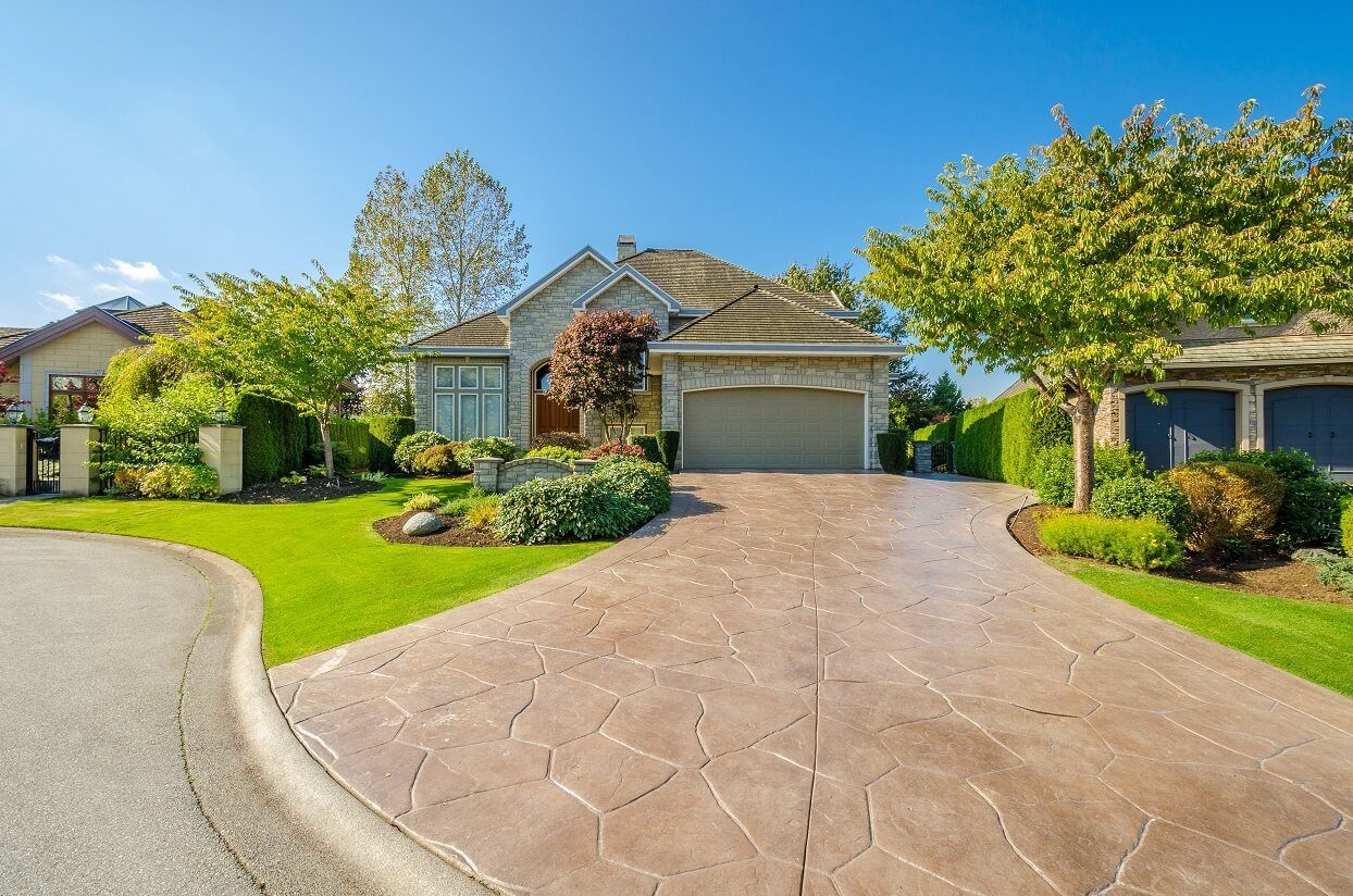 how to clean stamped concrete driveway